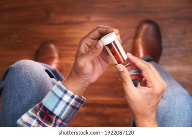 person hand holding pill container