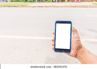 Person hand holding smartphone or mobile phone with white screen using on road - Shutterstock ID 481941370