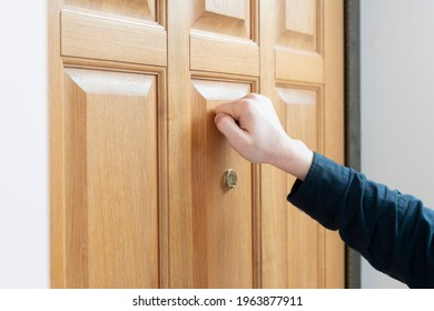 person hand knock the door, visit the friends house