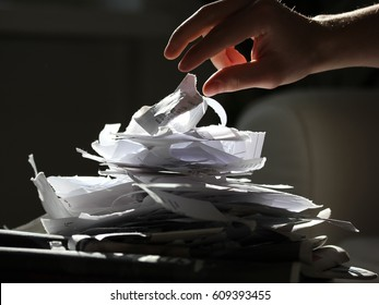 Person hand ripping documents