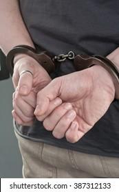 Person handcuffed.