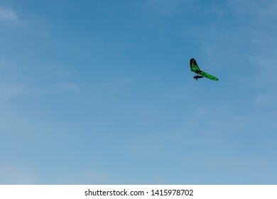 A person hang gliding on a clear day