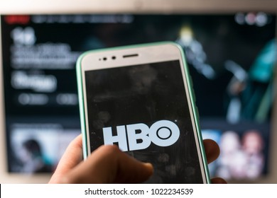 person with HBO in his mobile phone
