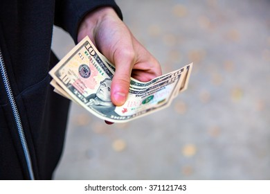 Person hold the Money on the Street closeup