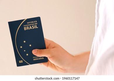 Person holding Brazilian Passport. Travel concept.   Translation: Federative Republic of Brazil. Mercosur passport.
