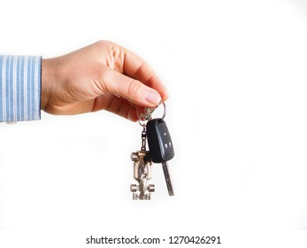 person holding car keychain and white isolated background
