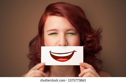 Person holding card in front of his mouth with ironic smile