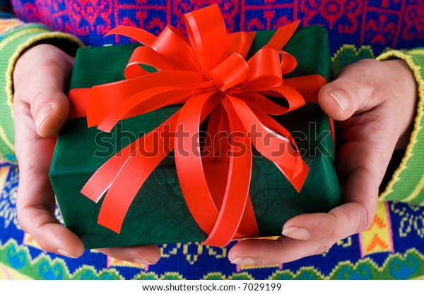 Person holding a Christmas present