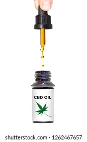 Person holding dropper of healthy medical marijuana CBD oil