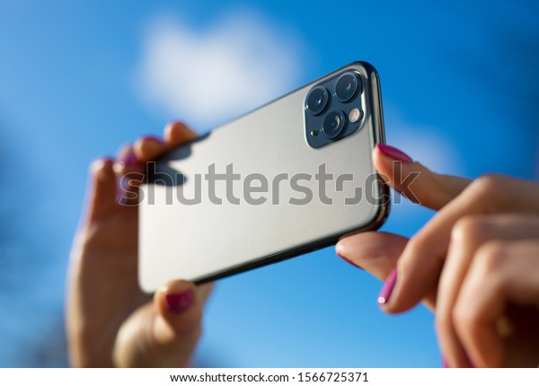 Person holding in hands modern smartphone