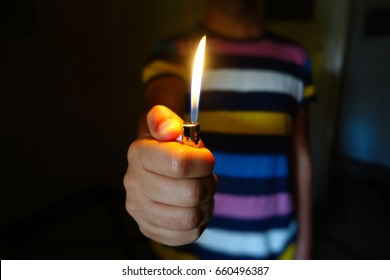 A person holding up a lighter