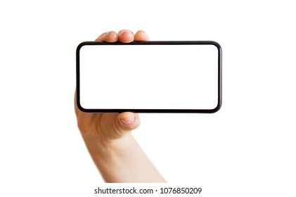 Person holding phone with empty white screen horizontally. Mobile app mockup.