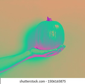Person holding a pumpkin on a yellow background synth wave style