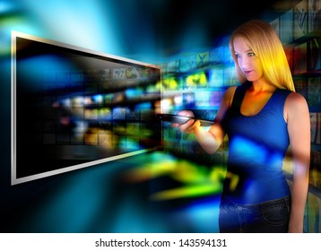 A person is holding a remote control and watching television on a widescreen tv with video images coming out on a black background.