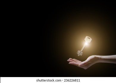 person holding shining key