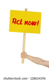 Person holding a sign saying Act now