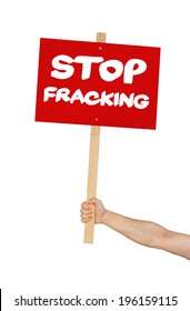 Person holding a sign saying Stop Fracking