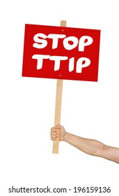 Person holding a sign saying Stop TTIP