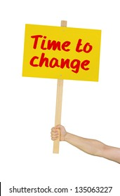 Person holding a sign saying Time to change
