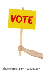 Person holding a sign saying Vote