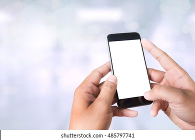 person holding a smartphone on blurred cityscape background man and phone