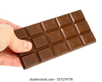 Person holding a whole bar of light chocolate isolated towards white background