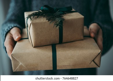 Person holds christmas or new year decorated gift boxes