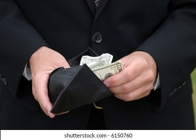 a person holds a fist full of money