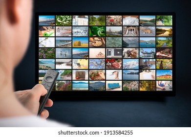Person holds remote control. VoD content provider concept. Television streaming video concept. Media TV video on demand technology. Online Video service with internet streaming multimedia