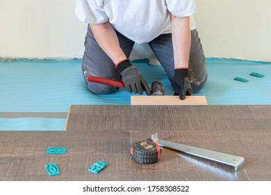 person-installing-laminate-floor-tools-2
