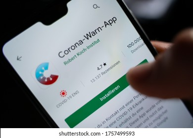 Person installs app Corona Warn App by Robert Koch Institut. GERMANY, HESSE - JUNI 16 2020