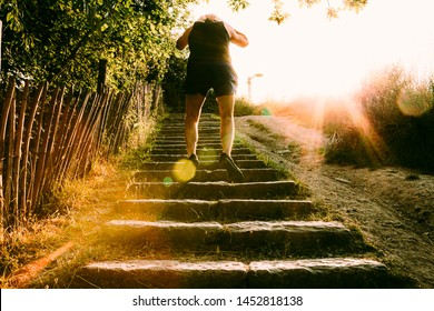 a person jumping on stairs in an outdoors training. healthy lifestyle concept