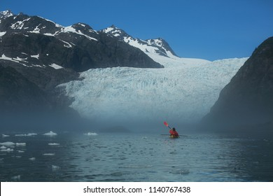 Person Kayaking up to Holgate Glacier in a Hazy Fog