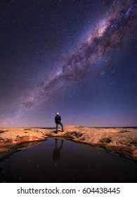A person looking up at the Milky Way