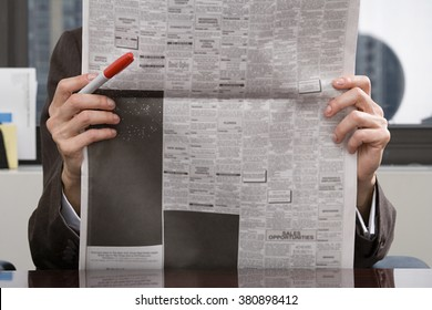 Person looking at newspaper