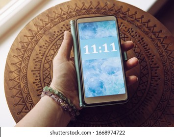 Person looking and seeing similar numbers. Seeing same similar numbers is called Angel numbers. Angels sending cryptic messages and communicating concept.