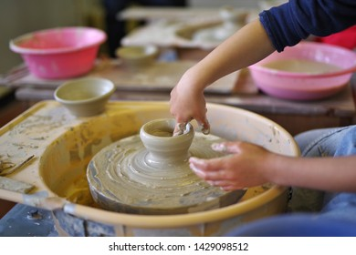 Person making pottery in pottery class