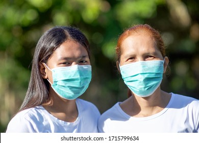 Person with mask.Asian female adult with facemask.Corona virus pandemic.Influenza.Indonesian and malaysian lady.Two women.