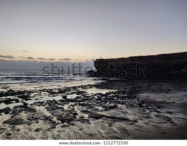 a person on the rocks silhouette