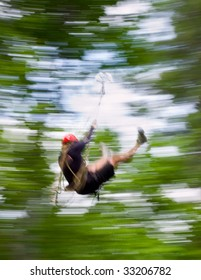 person on a zip line with motion blur