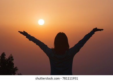 Person opening arms during sunrise