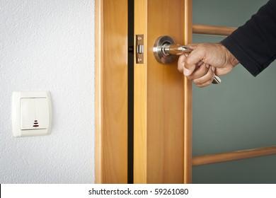 The person opens an interroom door