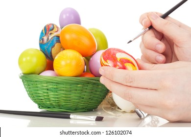 Person painting Easter eggs