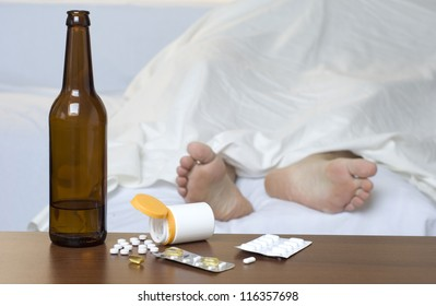 Person passed out in the bed after mixed use of alcohol and drugs.