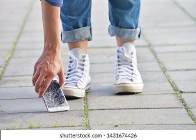 Person Picking Broken Smart Phone