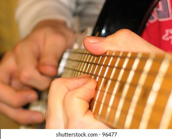 A Person Playing Guitar