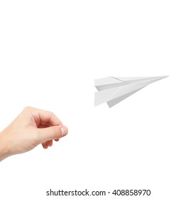 A person playing with paperplanes
