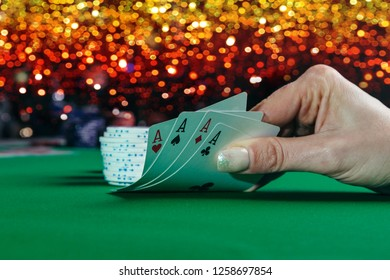 Person playing poker and looking winning cards. Concept win and lose in casino.