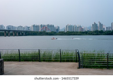 Person is playing a water-ski in the Hangang river.