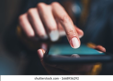 person point finger touch screen smartphone light night city, girls using in hands mobile phone closeup, online wi-fi internet, woman texting text message  - Shutterstock ID 1668936292